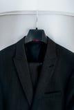 Wedding black suit hangs on hanger. White background Stock Images