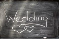 Wedding on blackboard and chalks. Stock Photo