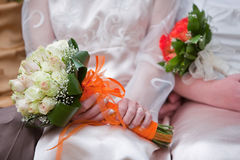 Wedding bloom. Bride and bridesmaid bouquets of flowers in beautiful red and white rosess Stock Photography