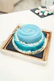 Wedding blue cake with mini balls on a desk stock photo