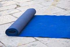 Wedding blue carpet. Wedding blue carpet rolled on pavement Stock Photo
