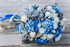 Wedding beauty blue wedding flowers. On the sea on the old wooden bridge royalty free stock photography