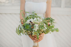 Wedding boho bouquet. Wedding bouquet with white flowers in the hands of the bride Royalty Free Stock Photo