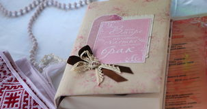 Wedding book close-up. Wedding book on table close-up stock video footage
