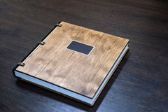 Wedding book with a wooden cover Stock Photography