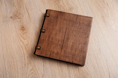 Wedding book with a wooden cover on a wooden texture Royalty Free Stock Photography