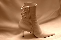 Wedding boot. On the white dress Stock Photography