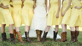 Wedding Boots. Bride and Bridesmaids show off their boots at a country wedding Royalty Free Stock Photos