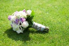Wedding Boquet. A beautiful wedding boquet on a green grass lawn royalty free stock photos