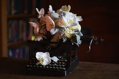 Wedding boquet and old typewriter.  Royalty Free Stock Photography