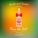 Wedding bottle of champagne with hearts over colorful blurred background. Stock Photography