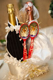 Wedding bottles with spoons Stock Photo