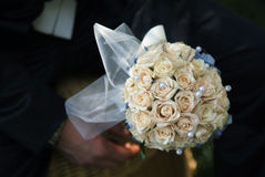 Wedding bouqet. A whithe wedding bouqet in hand stock photo