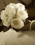 Wedding bouqet. Close up of bride's hand holding wedding bouquet, sepia toned Royalty Free Stock Photo