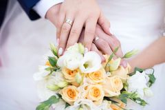 Wedding bouque. Beautiful wedding bouquet and hands of the newlyweds Stock Photo