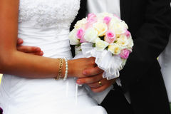 Wedding bouquet. Bride and groom holding the bouquet Stock Photos