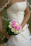 Wedding bouquet. Bride holding wedding bouquet of roses Royalty Free Stock Photo