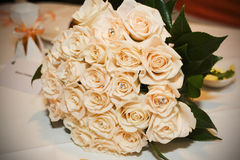 Wedding Bouquet. A bride's bouquet of flowers on the reception table Stock Photo