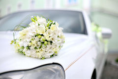 Wedding bouquet. Lies on the car. Wedding day. Summer Day Stock Photography