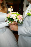 Wedding bouquet. Couple in love at wedding ceremonies. Holding a bouquet Stock Photos