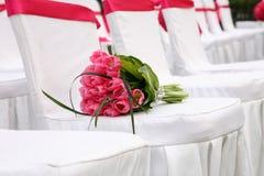 The Wedding bouquet. Wedding bouquet on a chair Stock Photos