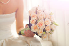 Wedding bouquet. At bride's hands