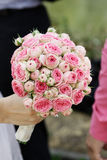 Wedding Bouquet. Beautiful wedding bouquet in gentle hands of the bride royalty free stock photos