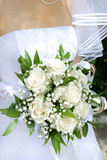 Wedding bouquet. Beautiful white wedding bouquet in hands of the bride Stock Photography