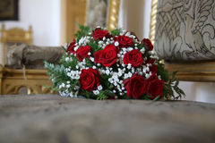 Wedding bouquet. Lying on an antique chair Royalty Free Stock Photos