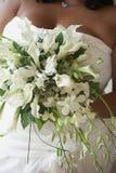 Wedding bouquet. In hands of beautiful african american bride Stock Photos