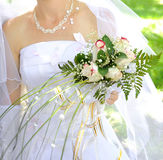 Wedding bouquet. Beautiful white wedding bouquet in hands of the bride Royalty Free Stock Photography