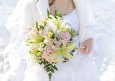 Wedding bouquet. Beautiful wedding bouquet in hands of the bride Stock Images