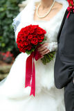 Wedding bouquet. A sharp red flower bouquet in a wedding Stock Images