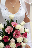 Wedding Bouquet. From colorful roses in hand of the bride Stock Photo