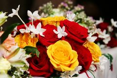 Wedding bouquet. A red and yellow wedding bouquet of roses Stock Photo