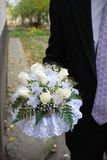 Wedding bouquet 2. Bridegroom take wedding bouquet with white roses stock images