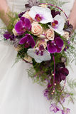 Wedding bouquet. Of beige roses and purple orchids Royalty Free Stock Photos