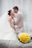 Wedding bouquet. With the wedding couple in the background Royalty Free Stock Photography