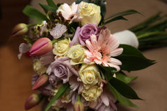 Wedding bouquet. A wedding bouquet of tulips, roses and gerbers Royalty Free Stock Image