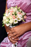 Wedding  bouquet. Bride holding her bouquet at the wedding Stock Image