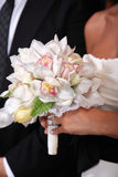 Wedding bouquet. Bride holding her bouguet at the wedding Stock Photo