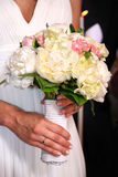 Wedding bouquet. Bride holding her bouquet at her greek orthodox wedding Royalty Free Stock Photos