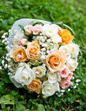 Wedding bouquet. Of roses on green grass Royalty Free Stock Images