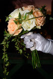 Wedding bouquet. A wedding bouquet whit a womans hand Stock Image