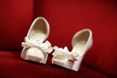 Wedding shoes. On a red sofa Stock Images