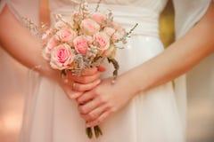 Wedding bouquet. In hands outdoor Stock Photography