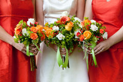 Wedding bouquet. Three wedding bouquets being held by a bride and her bridesmaids Royalty Free Stock Photos