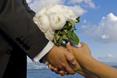 Wedding bouquet. The groom and the bride with wedding bouquet Royalty Free Stock Photography