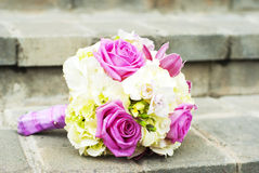 Wedding bouquet. Closeup photo of a wedding bouquet on stairs Stock Photos