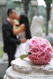 Wedding bouquet. In focus and couple in the background Stock Photo